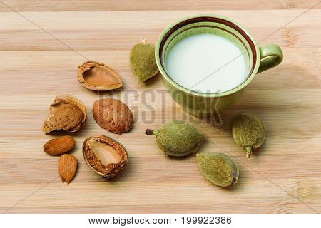 Almond milk. Representation of a cup with milk made with almonds.