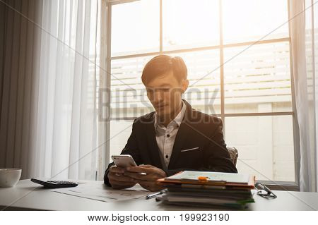 Asian male businessman is using a taxi phone application to attend the international business and government conference by international cooperation.