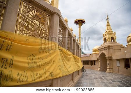 Large Golden Temple With Sky Background, Name Is Phra Maha Chedi Srivang Chai, Located In Lamphun, T