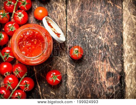 Ketchup From Tomatoes, Garlic And Spices In A Jar.