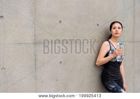 Slim Female Student Holding Water Bottle Drinking
