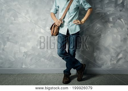 Vintage Men Clothings Retro Style With Low Key Lighting Over Loft Concrete Wall Background.