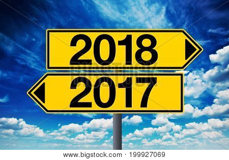 2017 and 2018 crossroad sign happy new year