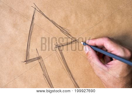 Hand sketching arrow symbol on paper as concept of decision making and choosing direction in life