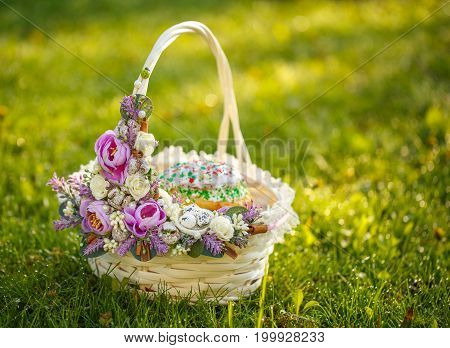 decorative Easter basket on the grass in the meadow