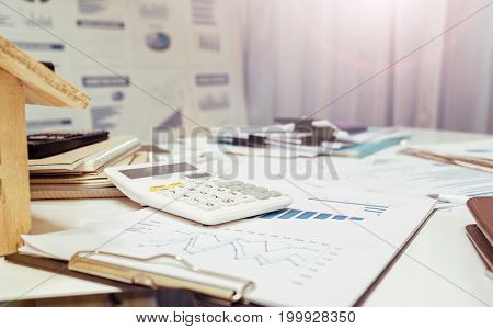 Office Paperwork Real Estate Concept At Working Table Desk.