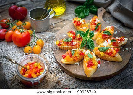 Bruschetta with tomato garlic and basil .