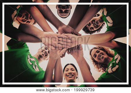 Smiling group of activists piling up their hands on white background