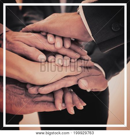 Business team stacking hands together in office