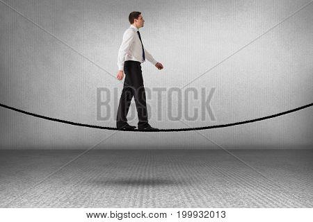 Handsome businessman stepping against grey room