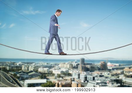 Businessman walking against cityscape against sky