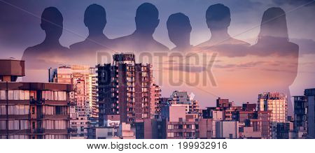 Business people against white background against buildings in city during sunset