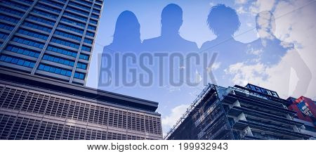 Colleagues standing against white background against building against cloudy sky