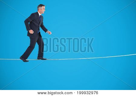Businessman walking on white background against blue background