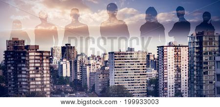 Illustrative image of business people against high angle view of modern buildings city