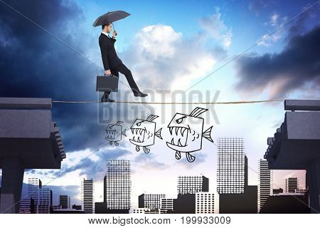 Businessman holding briefcase under umbrella against bridge over city