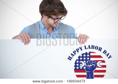 Handsome man holding blank panel against happy labor day text over cropped hand holding tools