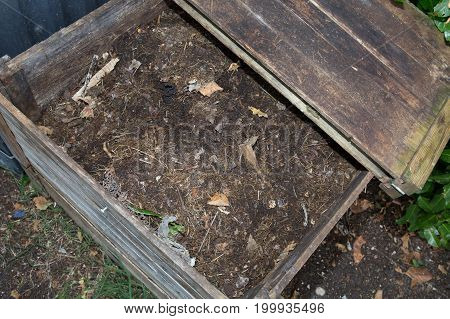 a wood Compost bin in the garden