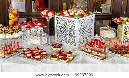 Beautifully decorated banquet catering with candy bar.