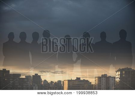 Business people standing over white background against city against cloudy sky during sunset