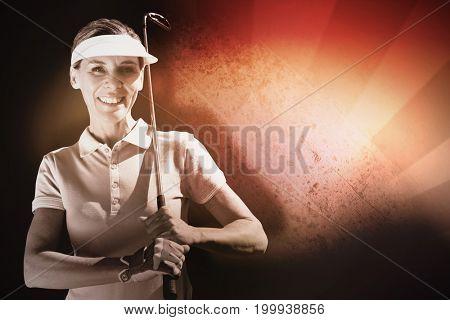 Woman playing golf against sunburst pattern