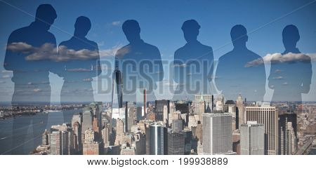 Silhouettes against one world trade center in city by river on sunny day