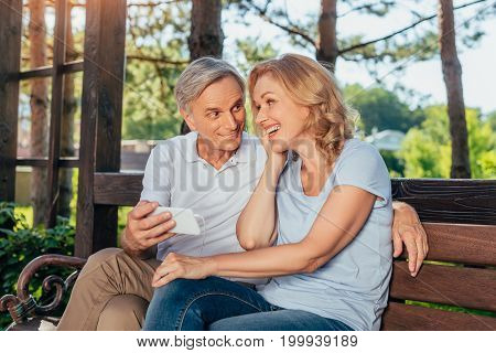 Senior Couple Using Smartphone Together