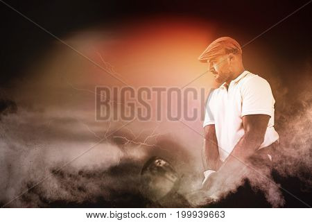Golf player taking a shot against digitally generated image of color powder