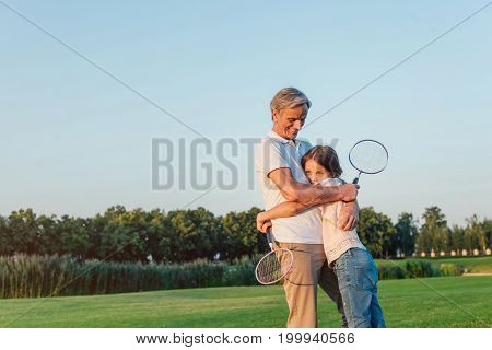 Grandfather And Granddaughter In Park