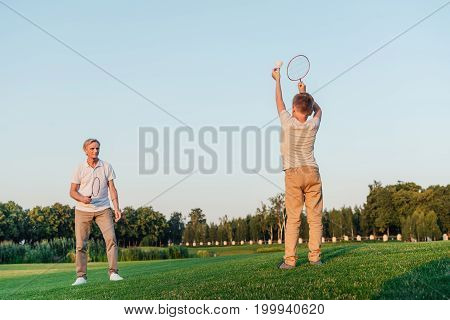 Family Playing Badminton Together