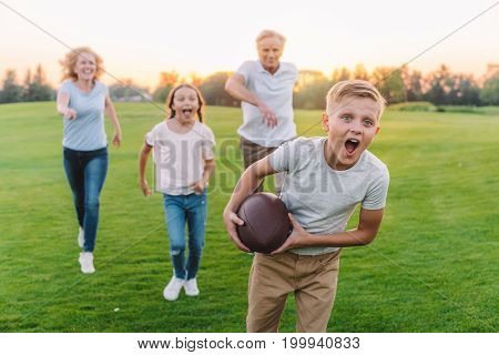 Family Playing American Football