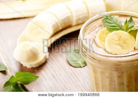 Banana healthy fresh smoothie on wooden table