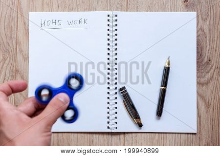 open notebook waiting for home work distracting spinner