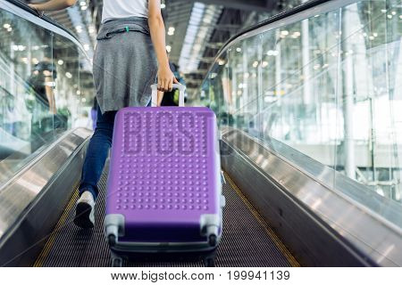 Young girl travel walking with carrying hold suitcase luggage and passenger for tour travel booking ticket flight in airport international vacation time in holiday rest and relaxation.