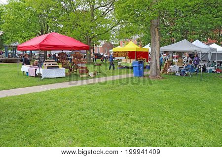 HAMILTON NEW YORK - MAY 27 2017: Vendors and shoppers at the local Saturday farmers market in the village of Hamilton near Colgate University in upstate New York.
