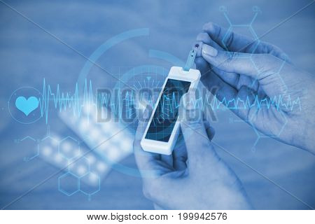 interface against close up of hands testing blood sugar with glucometer