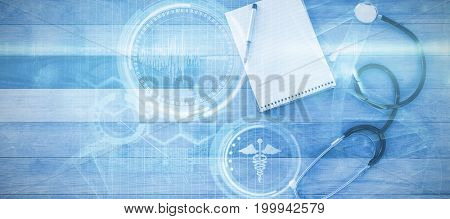 Digital composite image of DNA helix against stethoscope with pen and notepad