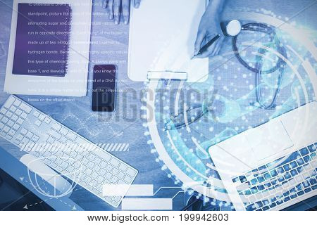 Digital image of DNA interface against overhead view of doctor writing on clipboard at desk
