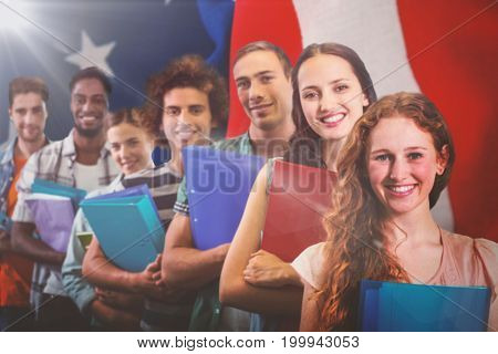 Fashion students smiling at camera together against crumbled american flag