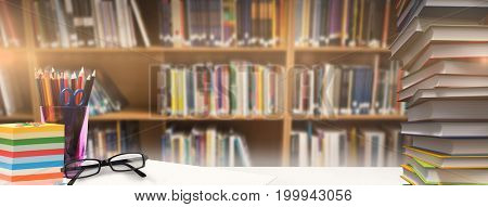 Students desk against various books on shelf