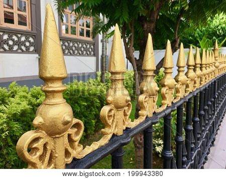 Iron Fence top details with painted golden spikes