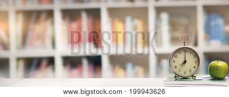 desk against defocused books on shelf
