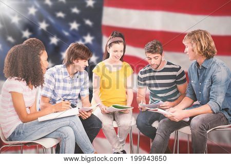 College students doing homework against close-up of an flag