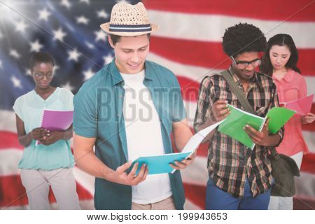Stylish students smiling at camera together against close-up of an flag