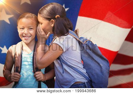 Girl with backpack whispering in friend ear against american flag with stripes and stars