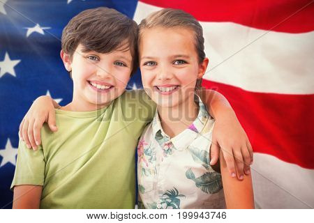 Portrait of happy siblings against close-up of flag