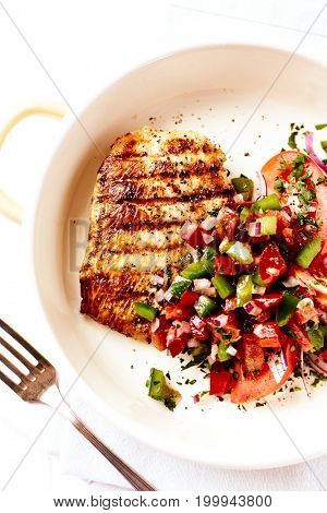 Grilled turkey breast fillet with tomatoes