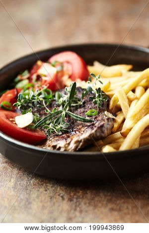 Grilled Steak with French Fries and Herbs