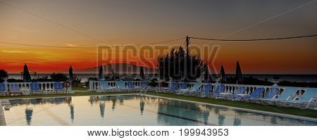 Swimming pool in the hotel at sunset. The island of Zakynthos. Greece, Ionian Sea