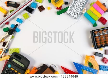 Frame Of Plastic Toy Blocks With Mathematics Tools And Equipment Isolated On White Background. Mathe